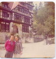 Central Europe Man and Woman in Front of Bavarian Style House